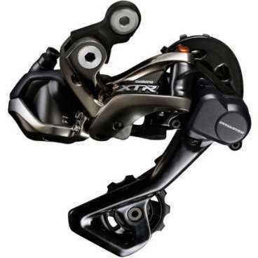 Переключатель передний SHIMANO XTR Di2 M9050, 2x11 ск., для 38-34T, без FD905, IFDM9050Переключатели скоростей на велосипед<br>Переключатель передний Shimano XTR Di2 M9050 11 Скоростей<br><br>Shimano XTR M9050 - первая электронная группа компонентов для маунтинбайка. Совершенно новый задний переключатель M9050 имеет в полтора раз более мощный мотор, чем его шоссейные аналоги. Привод спрятан глубже в корпусе переключателя. Такая конструкция позволит более эффективно работать в грязи, свойственной МТБ. Также как и механический задний переключатель, RD-M9050 имеет технологию Shadow RD+, позволяющую регулировать натяжение пружины переключателя с помощью шестигранника.<br>Характеристики:<br>Мгновенный переход к переключению<br>Бесшовные переключение передач<br>Совместим с Shimano Synchronized Shift<br>Система связи с передним переключателем <br>Преимущество в любых условиях<br>E-трубка электрический провод гарантирует стабильную работу<br>Низкопрофильные позиции RD на безопасном расстоянии от препятствий на трейле<br>1x, 2x и 3x совместимый с GS и SGS вариантами лапки<br>Материал лапки: алюминий<br>Крепление: средняя лапка или длинная лапка<br>Вес: 289г<br>