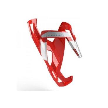 Велосипедный флягодержатель Elite Custom Race Plus, fiberglass, красный, белый рисунок. EL0140616Фляги и Флягодержатели<br>Флягодержательль Custom Race Plus, fiberglass, красный, белый рисунок<br>Флягодержатель Elite Custom Race Plus является эталоном среди гоночных флягодержателей и используется командами Про-Тура. <br>Новая запатентованная конструкция с более прочным захватом облегчает вставку / извлечение бутылки в экстремальных условиях.<br>Разработано и протестировано в сотрудничестве с лучшими в мире профессиональными командами.<br>Отличительные особенности<br>Флягодержатель для профессионалов велогонок<br>Выполнен из армирвоанного полиамида (FRP) с отделкой из окрашенного стекловолокна<br>Вставка из эластомера адаптируется к форме и размеру фляги<br>Отсутствие вибраций на неровностях трассы<br>Прочная, лёгкая и гибкая современная конструкция<br>Подходит для любого типа велосипедов<br>