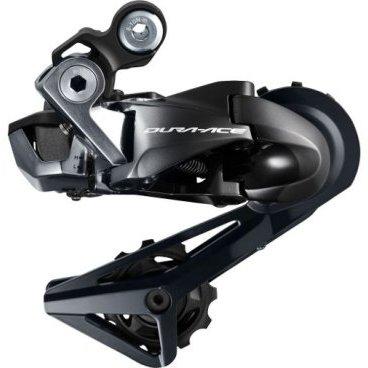Переключатель задний SHIMANO Dura-Ace Di2 R9150, SS, 11 скоростей, черный, KRDR9150SSПереключатели скоростей на велосипед<br>Полностью модернизированный для 2017 года, задний переключатель Dura Ace Di2 RD-R9150 сделан в полной гармонии с другими компонентами группы, чтобы обеспечить вам идеальную работу трансмиссии, и, конечно, теперь имеет специальные функциональные возможности Di2 (например, синхронизированное переключение). Переключатель отличается компактными размерами и хорошо защищен от повреждений даже в случае падения. Он также имеет тонкий профиль Shimano Shadow, который ещё точнее располагает цепь на соответствующей шестерне.<br><br>ОСОБЕННОСТИ<br><br>- Применение: шоссе, триатлон.<br><br>- Крепление: стандарт (совместимо с Direct Mount).<br><br>- Совместимость: 11-скоростное переключение Shimano.<br><br>- Материал наружного корпуса: карбон.<br><br>- Материал внутренней обоймы: карбон.<br><br>- Материал дополнительных компонентов: алюминий, карбон.<br><br>- эргономичная и легкая коммутация<br><br>- Синхронизированное переключение Shimano.<br><br>- Низкопрофильный переключатель Shimano Shadow RD.<br><br>- Компактный и чистый вид.<br><br>- Герметичные направляющие подшипники.<br><br>- Проект E-Tube обеспечивает обновление встроенного программного обеспечения.<br><br>- Количество разъёмов E-Tube: 1.<br><br>СПЕЦИФИКАЦИЯ<br><br>- Длина лапки: SS (короткая).<br><br>- Максимальное число зубьев наибольшей шестерни: 30T.<br><br>- Минимальное число зубьев наименьшей шестерни: 11T.<br><br>- Максимальная разница спереди: 16T.<br><br>- Общая вместимость: 33Т.<br><br>- Масса: 204 г.<br>