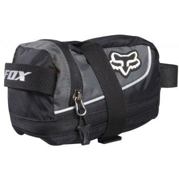 Сумка подседельная Fox Large Seat Bag, 18 х 12 х 10 см, черный, полиэстер/нейлон, 06550-001Велосумки<br>Большая подседельная сумка, в которую поместятся 2 камеры, мультитул, энергетический батончик и другие необходимые мелочи. Прочная синтетическая ткань, ремешки с липучками плотно и надежно удерживают сумку под седлом.<br><br>Подседельная сумочка Fox LARGE SEAT BAG<br><br>Цвет : черный/серый<br><br>Материал : полиэстер, нейлон<br><br>Объем : 1 л (увеличивается до 1.5 л)<br><br>Размеры : 18 х 12 х 10 см<br><br>Вес : 90 г<br><br>Особенности:<br><br>Объем сумочки можно увеличить на 0.5 л, расстегнув  нижнюю молнию<br>Светоотражающие элементы<br>Крепление для мигалки<br>Крепится ремнями к рамкам седла и подседельному штырю<br>
