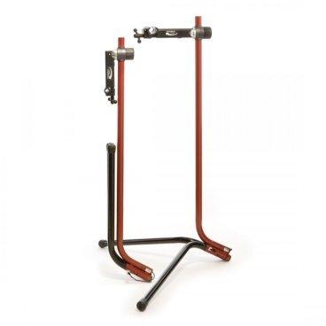 Стойка для велосипеда Feedback Recreational Work Stand BRS-50R, 13961Стенды<br>Компактная стойка для ремонта велосипедов, идеальная для небольших помещений. Стойка изготовлена из стальных труб с порошковой покраской; удобный фирменный зажим позволяет удерживать трубы диаметром до 48мм. Модель рассчитана на нагрузку до 27 килограммов.<br><br>ОСОБЕННОСТИ<br><br>Материал: алюминиевый сплав<br><br>Высота: 55 дюймов<br><br>Регулируемый зажим (от 19 до 48мм)<br><br>Ширина зажима: 82.5мм<br><br>Велосипед можно поворачивать на 360 градусов<br><br>Стойку легко сложить для хранения и транспортировки<br><br>Размеры в сложенном состоянии: 254х102х1410мм<br>