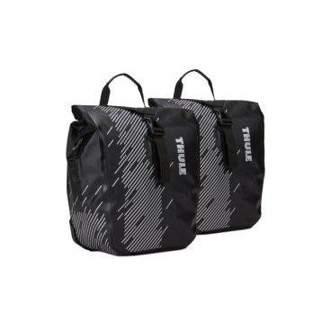 Набор велосипедных сумок Thule Shield Small, черный, 100075Велосумки<br>Эти универсальные водонепроницаемые велосипедные сумки со сворачивающейся верхней частью защищают вещи от влаги, а светоотражающие элементы обеспечивают дополнительную безопасность при езде.<br><br>Особенности:<br><br>Светоотражающие элементы на сумке делают ее более заметной в темное время суток<br>Запаянные швы и сворачивающаяся верхняя часть надежно защищают содержимое от влаги и пыли в соответствии с классом защиты IP64<br>Сумки легко устанавливать и снимать благодаря удобной системе зажимов и нижнему креплению на магнитах<br>Удобная точка крепления фонаря для дополнительной безопасности при передвижении<br>Во внутренних карманах можно расположить небольшие предметы<br>Сумка имеет встроенную ручку и съемный наплечный ремень для удобной транспортировки<br>Вес<br>0.9 кг<br>Водонепроницаемость<br>IP64<br>Материал<br>Нейлон, пластик, сталь<br>Номер модели<br>100075<br>Объем<br>14 л<br>Размеры<br>25.4 х 14 х 31.1 см<br>Цвет<br>Black<br>