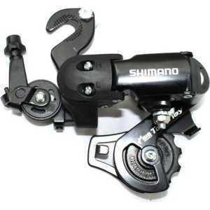 Переключатель задний Shimano Tourney FT35-A, 6/7 скоростей, крепление на петух, ERDFT35ADПереключатели скоростей на велосипед<br>Задний переключатель FT35   на шесть (или семь)  скоростей с короткой лапкой от известного производителя. Совместим с оборудованием серии Tourney. Выпускается в двух вариантах: креплением на ось и креплением на петух. Простая и надежная модель с интуитивно понятной настройкой.<br>