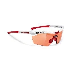 Очки Rudy Project GENETYK RAC. WHITE G.- IMPX PHT REDВелоочки<br>Очки Rudy Project GENETYKВ этой модели оправы, только верхняя часть линз защищена ободком. Это дает возможность увеличить поле зрения, при этом очки сохраняют прочную структуру. Такой дизайн обеспечивает прекрасный курсовой обзор, очки прекрасно подходят для таких видов, как велогонка, горный велосипед, когда необходимо хорошо видеть поверхность земли, чтобы объезжать препятствия и выбирать лучшую траекторию.Оправа из полимера Grilamid Frame это черизвычайно гибкая, ударопрочная, гипоолергенная, легкая оправа.E-Lock TM, и обеспечивающий отличную посадку и абсолютный комфорт;Система сменных линз Quick Change для разных условий освещенности;Система контроля параллельного зрения RP-D-Centered обеспечивает максимальную защиту от ультрафиолета и оптическую резкость;Высококачественные поликарбонатные линзы с защитой от ультрафиолета обеспечивают максимальную резкость;Линзы ImpactX PhotohromicImpactX™ представляет собой на сегодняшний день наиболее продвинутое решение в области защиты зрения. Линзы, сделанные из материала NXT, обеспечивают острое зрение и не имеющий равных комфорт. Линзы самозатемняющиеся в зависимости от степени ультрафиолетового излучения, являются уникальным, передовым решением. Вам больше не нужно несколько очков на разные погодные условия. Линзы ImpactX Photohromic подстраиваются под интенсивность света и затемняются сами, вы даже не заметите этого. Только комфорт.                                                 Общие характеристики:    Артикул:SP118469RC    Брэнды:Rudy Project        Категория:Очки<br>