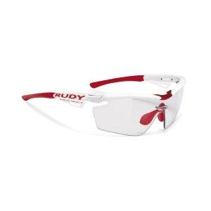 Очки Rudy Project GENETYK RAC.PRO WHITE GLOSS ImpX 2 PHT BLACKВелоочки<br>Очки Rudy Project GENETYKВ этой модели оправы, только верхняя часть линз защищена ободком. Это дает возможность увеличить поле зрения, при этом очки сохраняют прочную структуру. Такой дизайн обеспечивает прекрасный курсовой обзор, очки прекрасно подходят для таких видов, как велогонка, горный велосипед, когда необходимо хорошо видеть поверхность земли, чтобы объезжать препятствия и выбирать лучшую траекторию.Оправа из полимера Grilamid Frame это черизвычайно гибкая, ударопрочная, гипоолергенная, легкая оправа.E-Lock TM, и обеспечивающий отличную посадку и абсолютный комфорт;Система сменных линз Quick Change для разных условий освещенности;Система контроля параллельного зрения RP-D-Centered обеспечивает максимальную защиту от ультрафиолета и оптическую резкость;Высококачественные поликарбонатные линзы с защитой от ультрафиолета обеспечивают максимальную резкость;Линзы ImpactX PhotohromicImpactX™ представляет собой на сегодняшний день наиболее продвинутое решение в области защиты зрения. Линзы, сделанные из материала NXT, обеспечивают острое зрение и не имеющий равных комфорт. Линзы самозатемняющиеся в зависимости от степени ультрафиолетового излучения, являются уникальным, передовым решением. Вам больше не нужно несколько очков на разные погодные условия. Линзы ImpactX Photohromic подстраиваются под интенсивность света и затемняются сами, вы даже не заметите этого. Только комфорт.                                                 Общие характеристики:    Артикул:SP117369ORC    Брэнды:Rudy Project    Год:2016    Категория:Очки<br>
