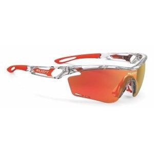 Очки Rudy Project TRALYX CRYSTAL GLOSS - MLS ORANGEВелоочки<br>ОписаниеОчки Rudy Project TRALYX CRYSTAL GLOSS - MLS ORANGEПрименениеСпортивные очки для занятия велосипедом, бегом, лыжами, активного отдыха.Tralyx - одна из самых продвинутых и технологичных моделей Rudy Project, способная покорить с первого взгляда. Любимые очки многих профессионалов и любителей спорта вполне заслужили свою репутацию: они сочетают лучшую функциональность с более высокими характеристиками и качеством линз, чем у конкурентов. Аэродинамический дизайн сотверстиями для вентиляции создан на основе научных исследований и обеспечивает оптимальную циркуляцию воздуха для предотвращения запотевания очков.Профиль выполнен таким образом, что потоки нагнетаемого воздуха не мешают зрению. Глаза надёжно защищены от попадания пыли, песка, брызг и любого крупного мусора за счёт прочного матерала оправы идеформируемых линз, не образующих осколков даже при сильном повреждении.ТехнологииADJUSTABLE NOSE PIECEРегулируемый наносник позволяет изменить посадку и добиться максимального комфорта.ADJUSTABLE TEMPLESРегулируемые заушины для лучшей фиксации очков вне зависимости от формы головы.GRILAMID FRAMEДля особой долговечности рамка очков изготовлена из Grilamid® - это лёгкий ударопрочный гипоаллергенный высококачественный термопласт стабильный при длительном использовании и перепадах температуры.QUICK CHANGE SYSTEMСистема Quick Change позволяет осуществлять быструю замену линз разного типа и размера. Это обеспечивает наибольшую функциональность и идеальные условия для зрения при любых погодных условиях.LENS SHAPESШирокий диапазон регулировок для подгонки посадки всегда был отличительным качеством продукции Rudy Project. Новые линзы размеров SX и XL - ясное подтверждениеэффективной работы в заданном направлении. Размер соответствует форме лица и обеспечивает оптимальные условия и защиту для глаз.POWERFLOWНовая система PowerFlow обеспечивает беспрецедентную терморегуляцию благодаря научному подходу к исследован